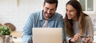 Man and woman behind computer