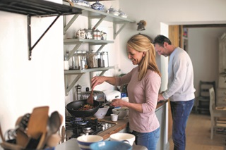A man and a woman cooking